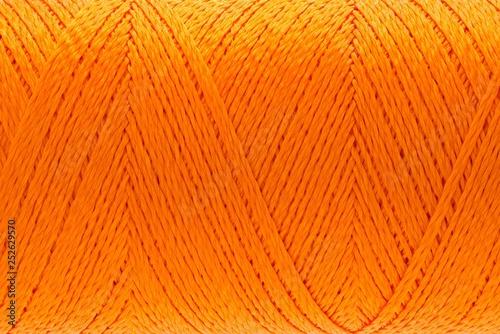 Fotografia  Macro picture of thread texture orange color background