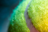 Tennis ball close up macro image as background