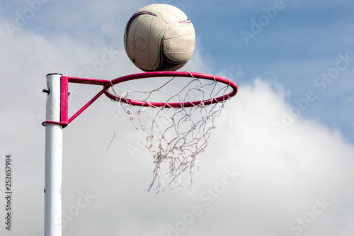 Vászonkép Netball post with ball about to go through the net