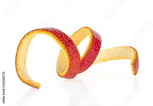Cuadros en Lienzo Sicilian orange peel on a white background. Orange zest spiral.