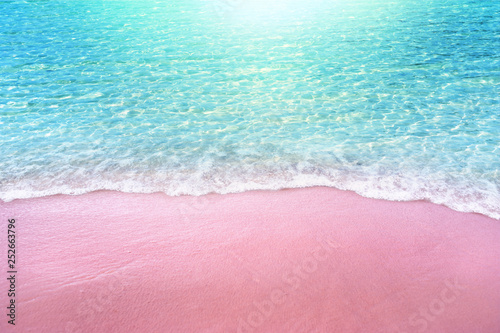 Photo  pink sandy beach and soft blue ocean wave summer concept background