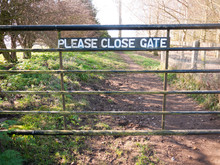 Please Close Gate Sign On Meta...