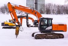 Excavators On A Winter Building Site