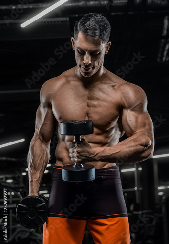 sexy strong bodybuilder athletic fitness man pumping up