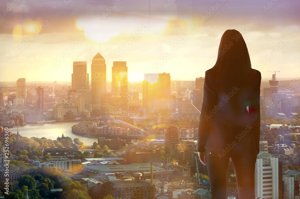Fototapety, obrazy: Young woman looking over the City of London at sun set. Future, new business opportunity and business success concept.