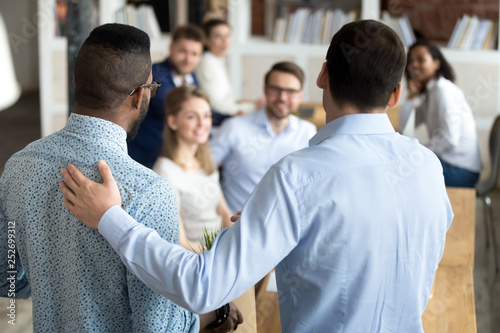 Boss introducing black new worker to workmates Wallpaper Mural