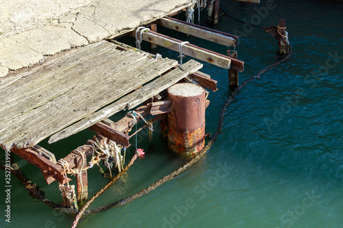 Poster Afrique du Sud Old damaged wooden jetty at sea harbour