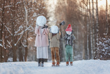 Happy Family! Family Sculpts Snowman In The Winter Forest. Walking In The Winter Holidays In Nature.