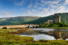 Evening Light On Restored Eilean Donan Castle With Sun On Added Stone Arch Footbridge To The Island In Scottish Highlands Scotland UK