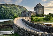 Evening Light On Restored Eilean Donan Castle On Island At Three Lochs With Added Stone Arch Footbridge Scottish Highlands Scotland UK