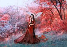 Powerful Autumn Nymph, Queen Of Fire And Goddess Of Hot Sun, Lady In Long Red Light Dress With Loose Sleeves With Dark Hair, Model In Scarlet Forest With Flying Owl, Bloody Mary, Vampire Image