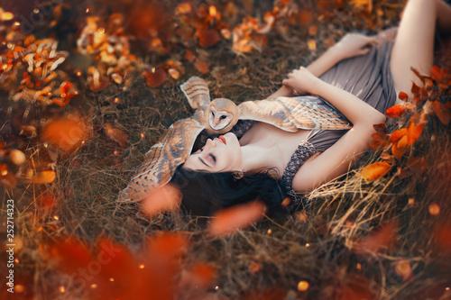 Fotografie, Obraz  bright autumn art photo, goddess rests in autumn orange forest under protection