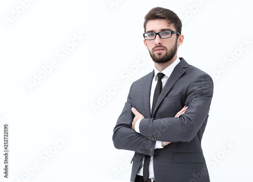 Casual young businessman standing arms crossed, smiling