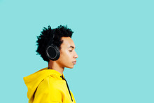 Profile Portrait Of A Young Man With Headphones Listening To Music With Eyes Closed