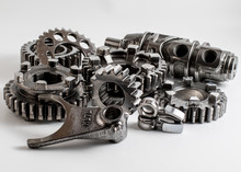 Transmission Parts From A Race Motorcycle Engine On A Reflective Background