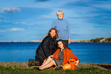 A Seventy-year-old Woman, A Forty-year-old Woman, And A Twenty-year-old Woman. Three Generations Of Women In The Family Outdoors. Mother, Daughter And Granddaughter