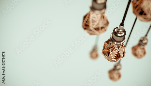 Photo  Unusual 3d illustration of hanging stylized low poly light bulbs with golden wire