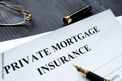 Fotomural Private Mortgage Insurance PMI form with pen.