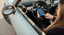 Girl Using Smartphone App To Pay For The Parking.