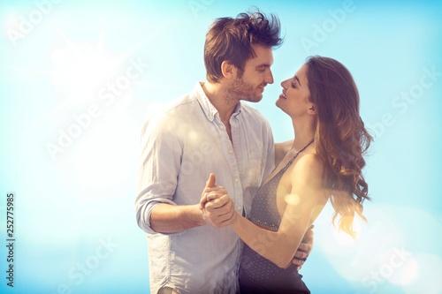 Loving couple kissing at summertime Poster Mural XXL