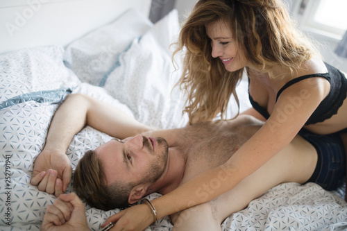 Happy couple in bedroom enjoying romantic moments