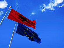 Albania Flag EU Flag Silk Waving Flags Republic Of Albania With Black Eagle Emblem On Red  And European Union With A Flagpole On A Sunny Blue Sky Background With White Clouds 3D Illustration