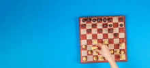 Kid Hands Over A Chessboard Pl...