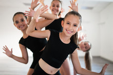 Group Of Young Fit Dancers Practicing During Class School