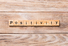 Positivity Word Written On Wood Block. Positivity Text On Wooden Table For Your Desing, Concept