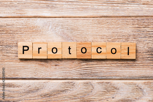 Fotografía  PROTOCOL word written on wood block
