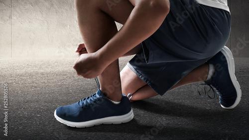 Foto op Canvas School de yoga Man tying running shoes