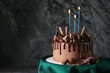 Birthday Chocolate Cake With Candles On Grey Background