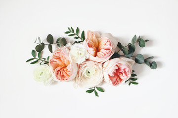 Fototapeta Egzotyczne Floral arrangement, web banner with pink English roses, ranunculus, carnation flowers and green leaves on white table background. Flat lay, top view. Wedding or birthday styled stock photography.