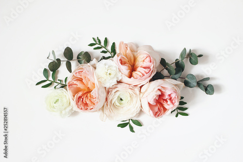 Poster Fleur Floral arrangement, web banner with pink English roses, ranunculus, carnation flowers and green leaves on white table background. Flat lay, top view. Wedding or birthday styled stock photography.
