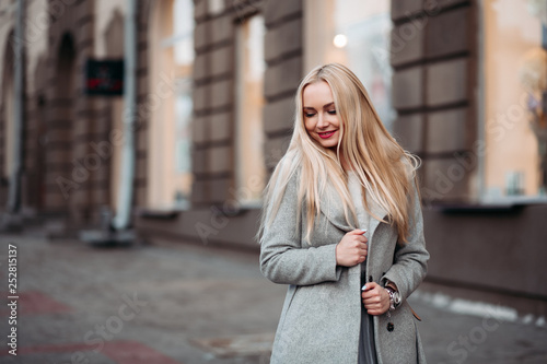 246828be0f52 Gorgeous blonde girl wearing in gray coat after beauty salon and shopping.  Concept of fashion and street style.