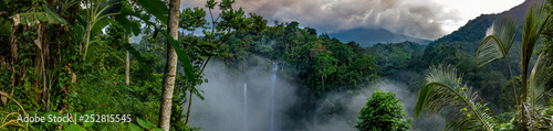 Leinwand Poster Aerial over Sekumpul waterfall surrounded by dense rainforest and mountains shro