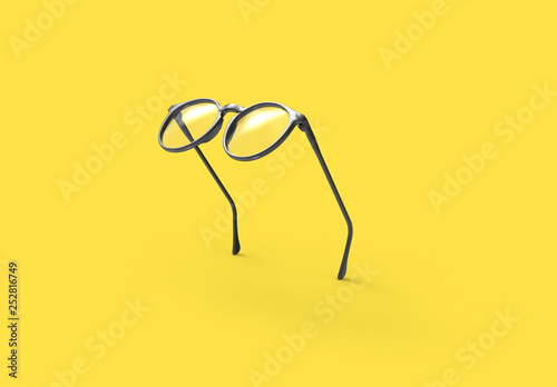 Photographie Studio shot of flying Black glasses on yellow background