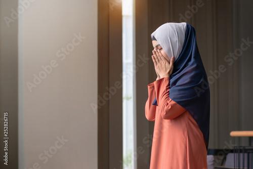 Fotografie, Obraz  Muslim woman praying in public, concept religion of Islam
