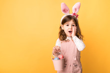 Girl With Bunny Ears Holding A...