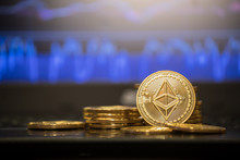 Ethereum Gold Coin And Defocused Chart Background.