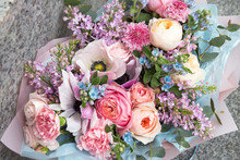 Beautiful Rich Elegant Wedding Pink Bouquet, Flowers Arrangement By Florist With Roses, Lilac And Blue Flowers. Floral Background