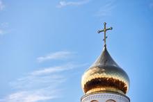 Golden Dome And Cross Of Church Of The Beheading Of St. John The Baptist  In European City Grodno