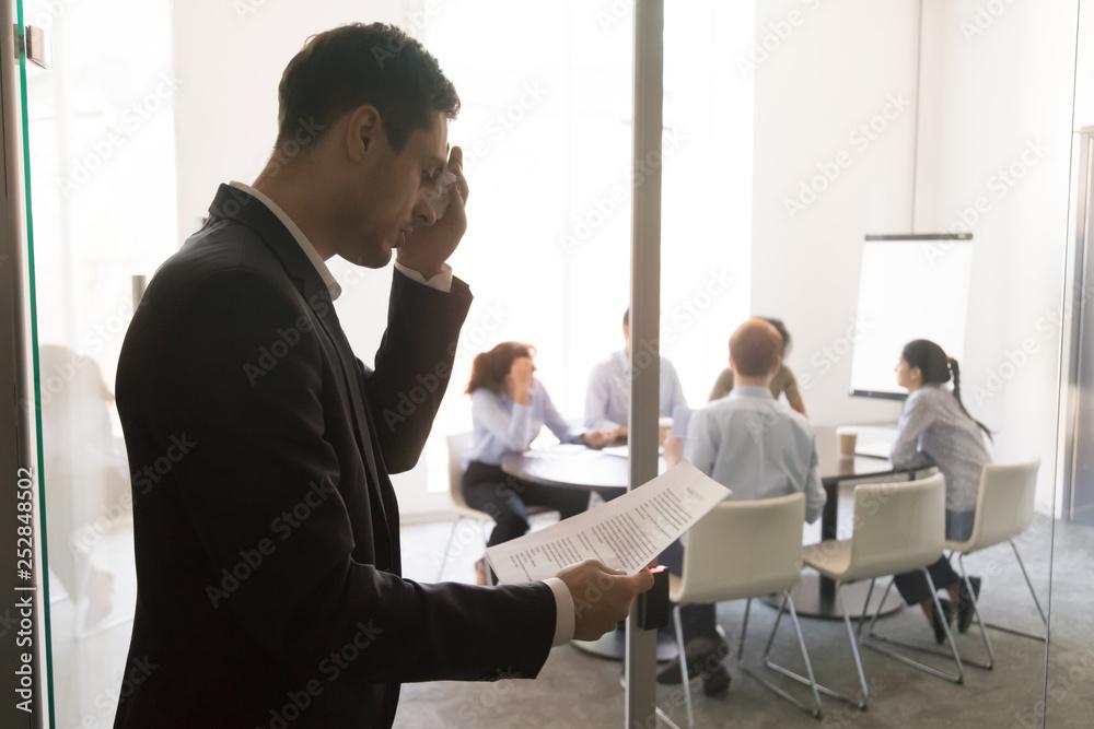 Fototapeta Nervous stressed sweaty businessman speaker feel public speaking fear
