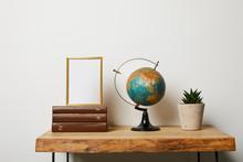 Frame On Books Near Globe And ...