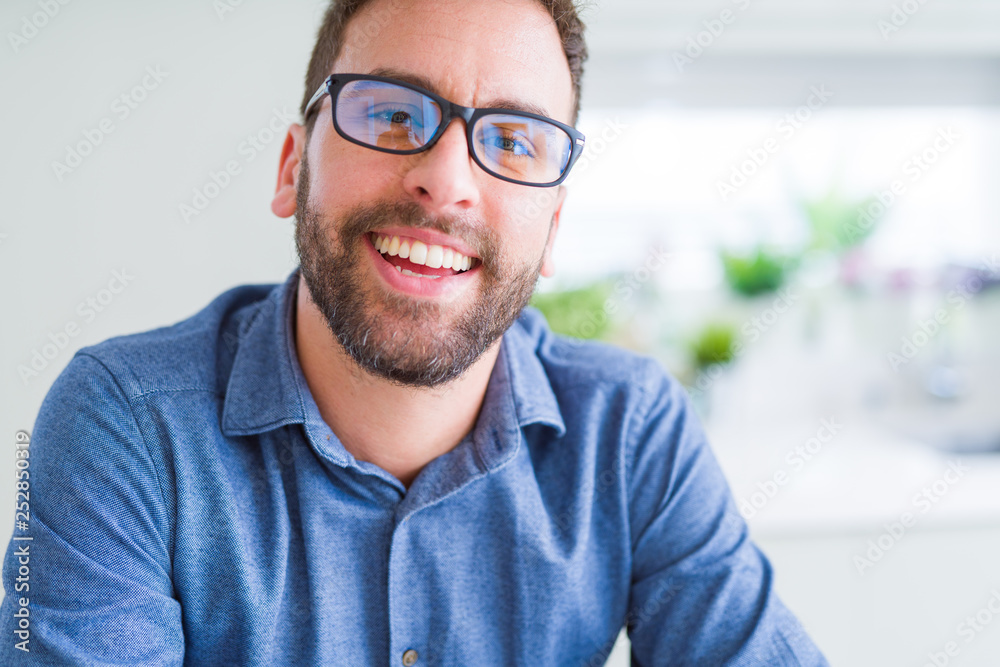 Fototapety, obrazy: Handsome man wearing glasses and smiling relaxed at camera