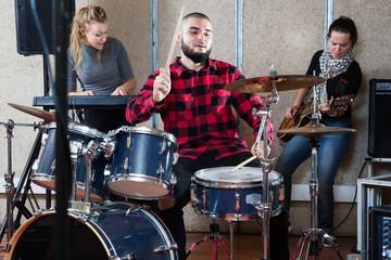 Garage band rehearsing in studio