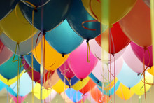 Helium Balloons With Ribbons In The Office. Colorful Festive Background For Birthday Celebration, Corporate Party