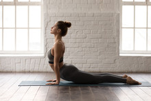 Young Woman Practicing Yoga, L...