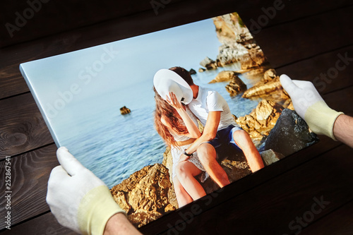 Fototapeta Photography printed on canvas with gallery wrap method of canvas stretching. Photo of kissing couple in love is in male hands obraz