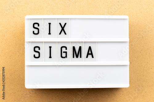 Fotografie, Obraz  Light box with word six sigma on wood background